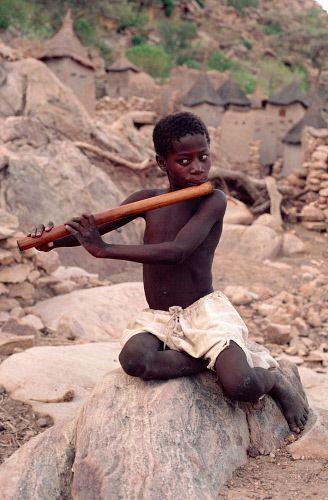 Africa   Apono, a Dogon boy, playing a wooden flute. Mali ...