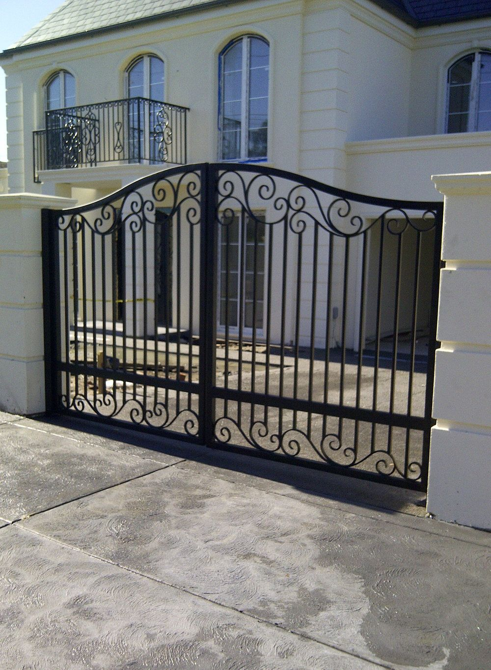 A unique wrought iron gate by Adoore Iron Designs located ...
