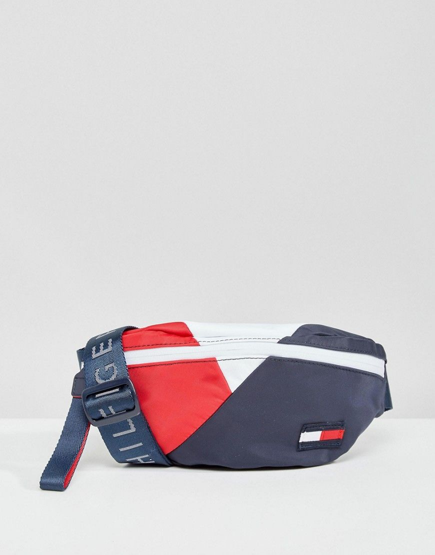 4830b75daf TOMMY HILFIGER RETRO LOGO FANNY PACK - MULTI.  tommyhilfiger  bags  belt  bags  canvas  denim