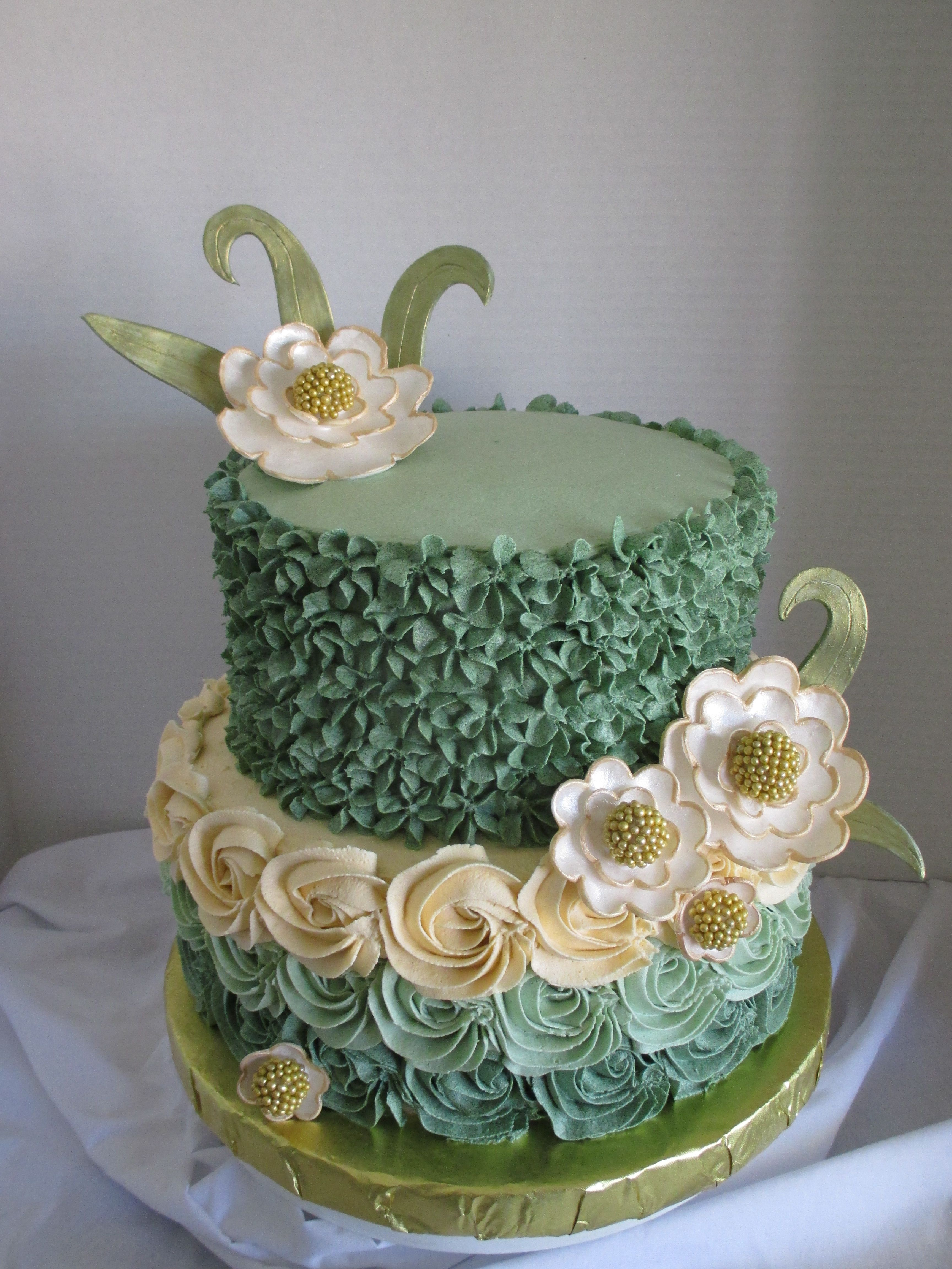 Buttercream roses on bottom and drop flowers on top Green ombre