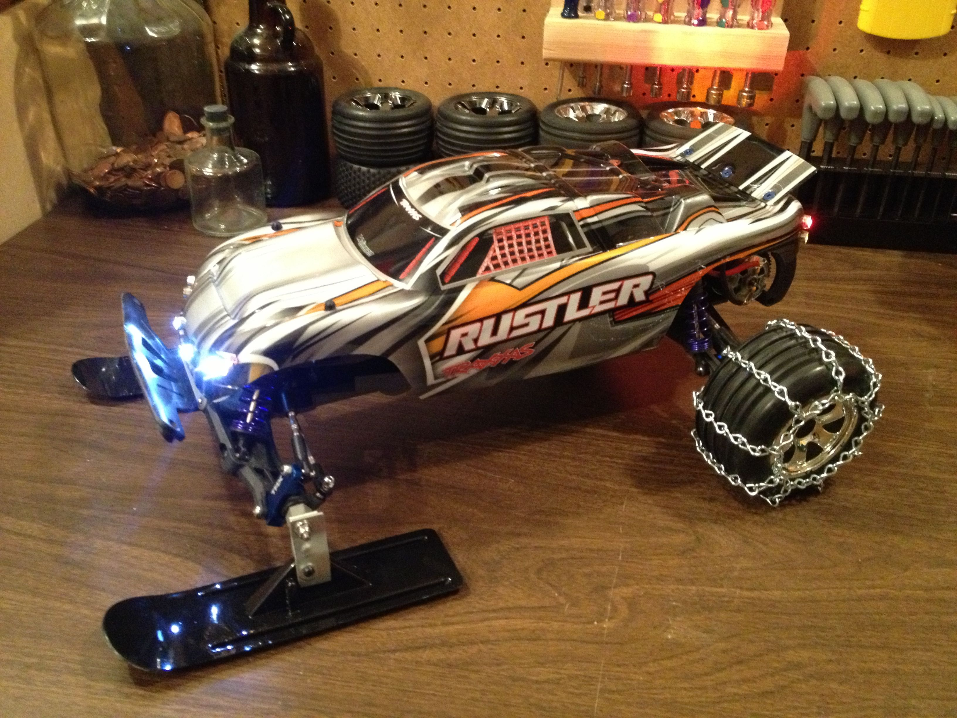 My Traxxas Rustler XL5 front snow skis, rear chains, and