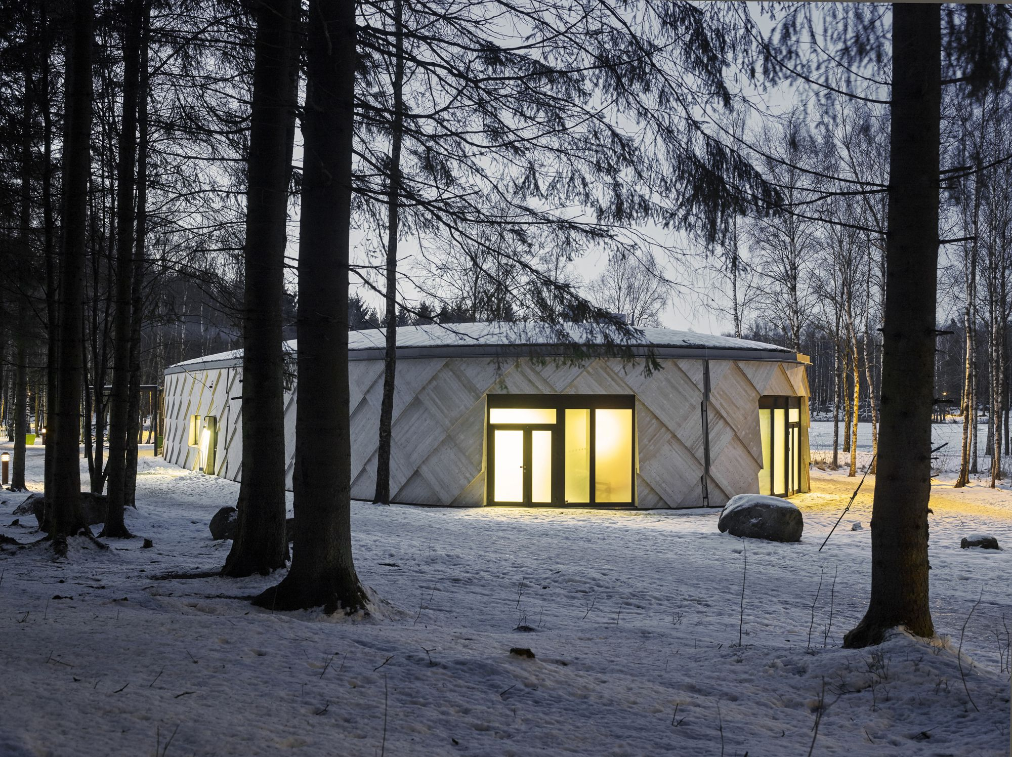 Completed in 2014 in Kungälv, Sweden. Images by Ulf Celander. Kotten - A Modern trail Center  Following the total destruction of the old trail centre in a fire in 2013, Kungälv municipality arranged an...