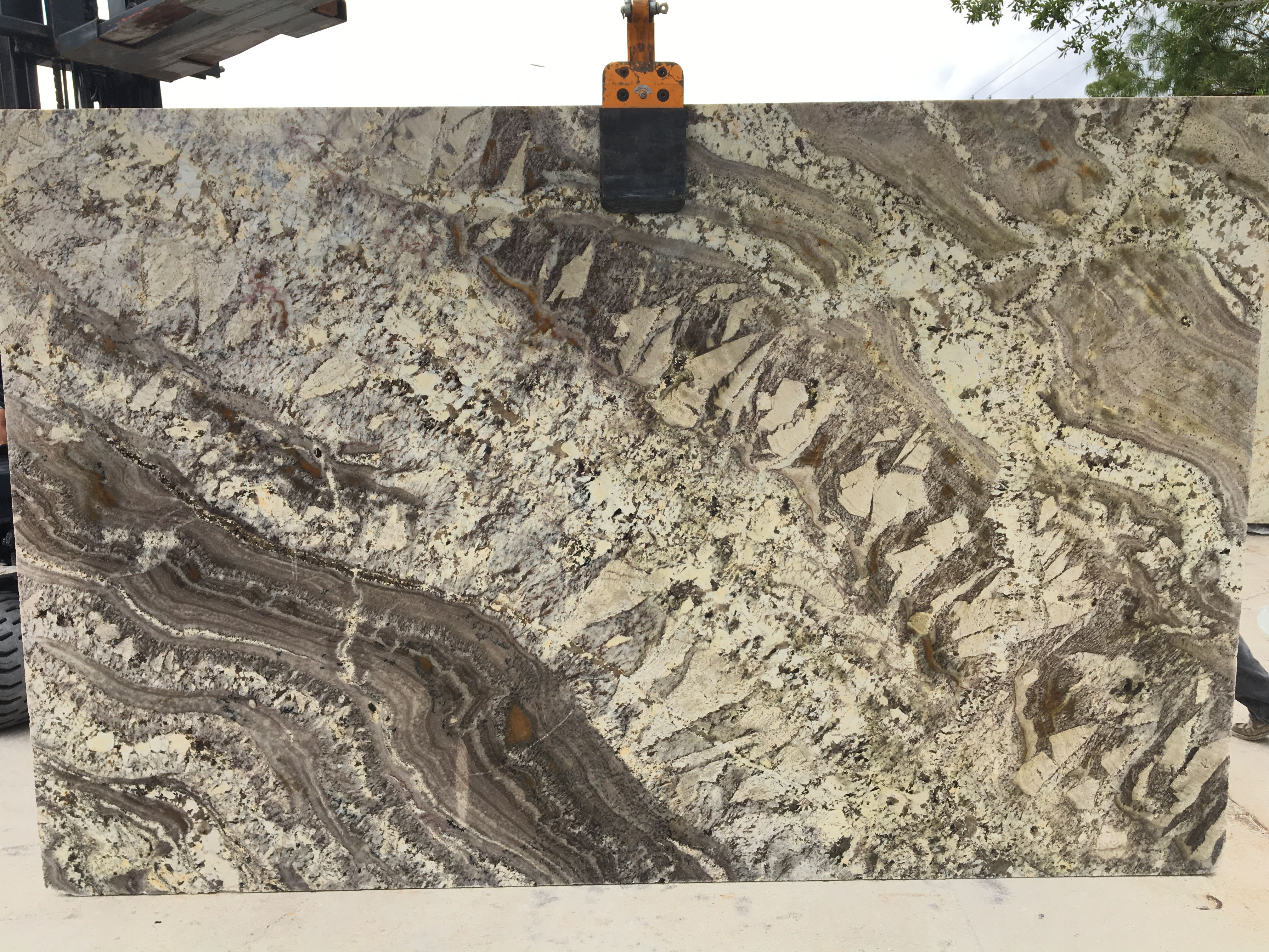 Sedona Granite Is Infused With Lots Of Movement From Dark Brown And Gray Swirls Over A Creamy White And Tan Grey Granite Granite Granite Countertops