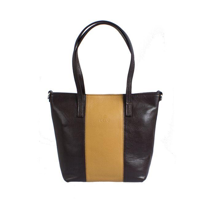 """""""Polku-laukku on muodoltaan klassinen, mutta väritykseltään leikittelevä. Polku-laukku pysyy mukanasi vuosia ja tallettaa sisäänsä kaikki rakkaimmat muistosi. Laukku, joka symboloi meidän jokaisen matkaa halki elämän jännittäviä polkuja. Minkä värinen on sinun polkusi?"""""""