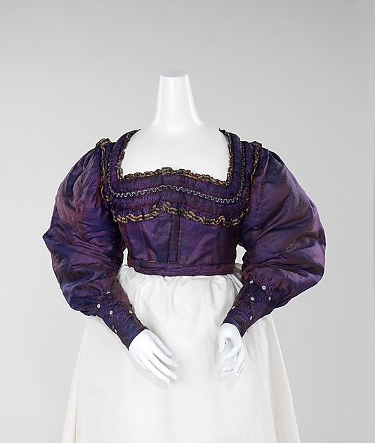 "Bodice: 1830-1835, German (probably), silk, cotton. ""This is an unusual garment, combining fashionable silhouette with regional detail. The lining and braid suggests that it is part of a German folk costume, but it is in the highly fashionable shape of the 1830s. Much skilled handwork went into the fabric manipulation as well as an interesting use of the ombré striped border as a decorative detail and pleated around the neckline forming a ruffle."""