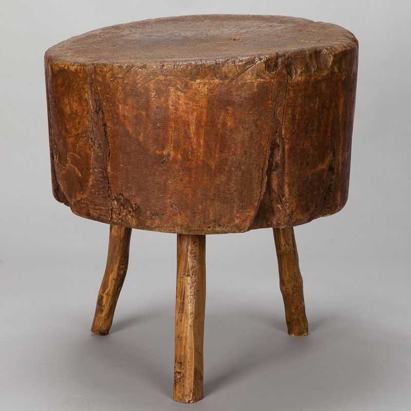 Found In France, This Century Primitive, Thick Round Butcher Block Table  Mounted On Three Branch Form Legs Dates From Approximately
