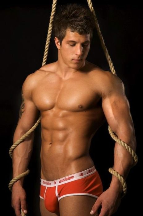 Two hot athletic guys tied up by others