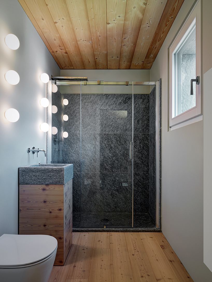 Love the panel timbers in the ceiling of this modern Italian bathroom