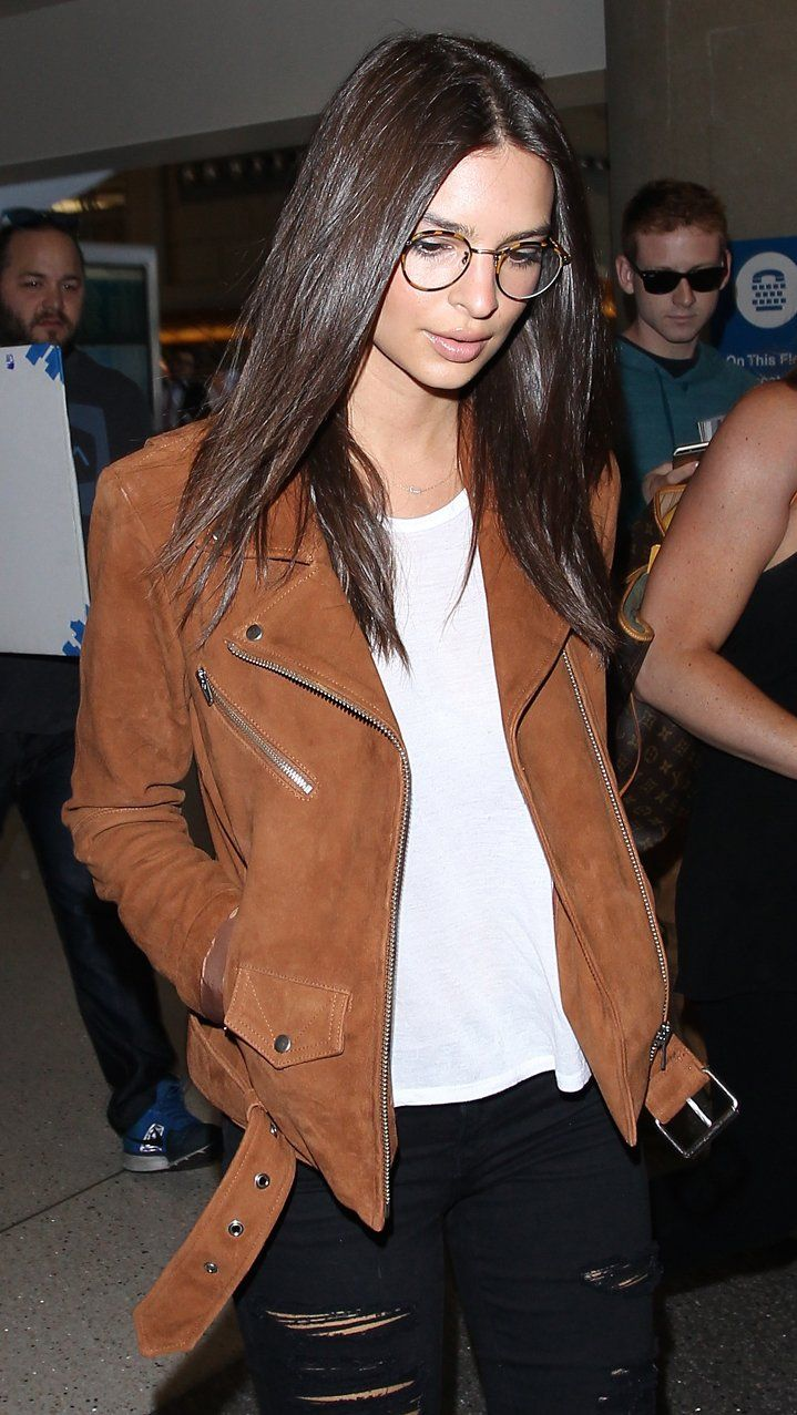 3b8c3ee7a4 Emily Ratajkowski took to the airport in a brown suede motorcycle jacket