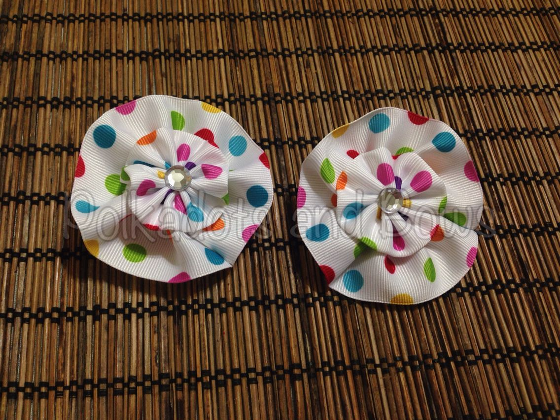 """1.5"""" Polkadots double layer flower with rhinestones. Attached on an alligator clip."""