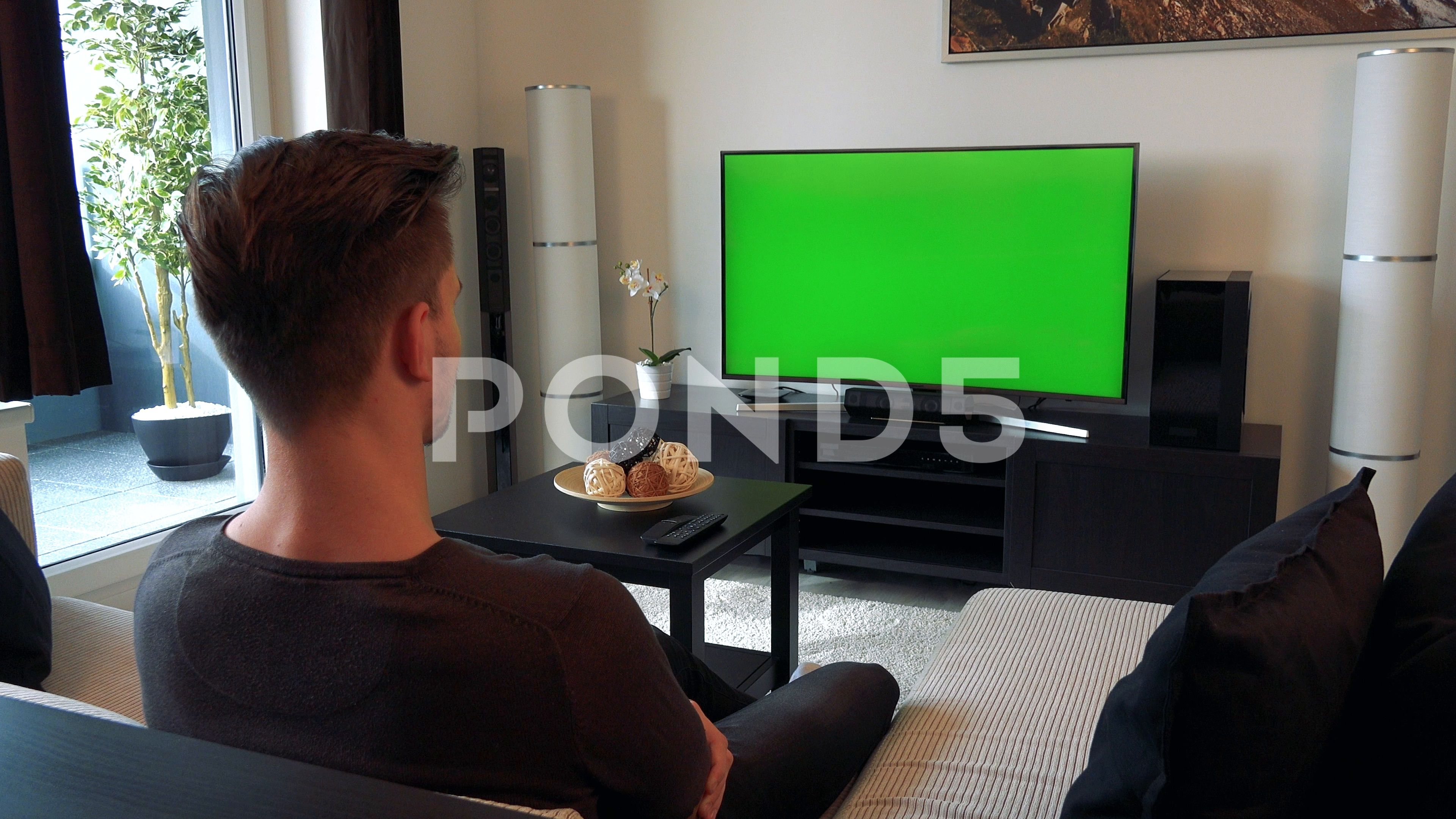 A Man Watches A Tv With A Green Screen In A Cozy Living Room Stock Footage Green Screen Tv Man Greenscreen Watches For Men Man
