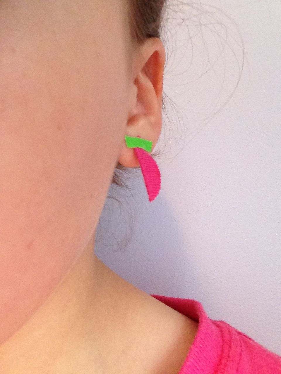 Tape earrings made out of duck tape and scraps of fabric