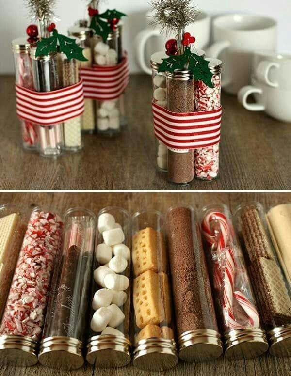 Hot chocolate bar ideas.. Crushed candy canes. Marshmellow.  Chocolate chips. Carmel. Whipped topping. Can put sparkly silver and blue duct talw around Carmel and whipped bottles