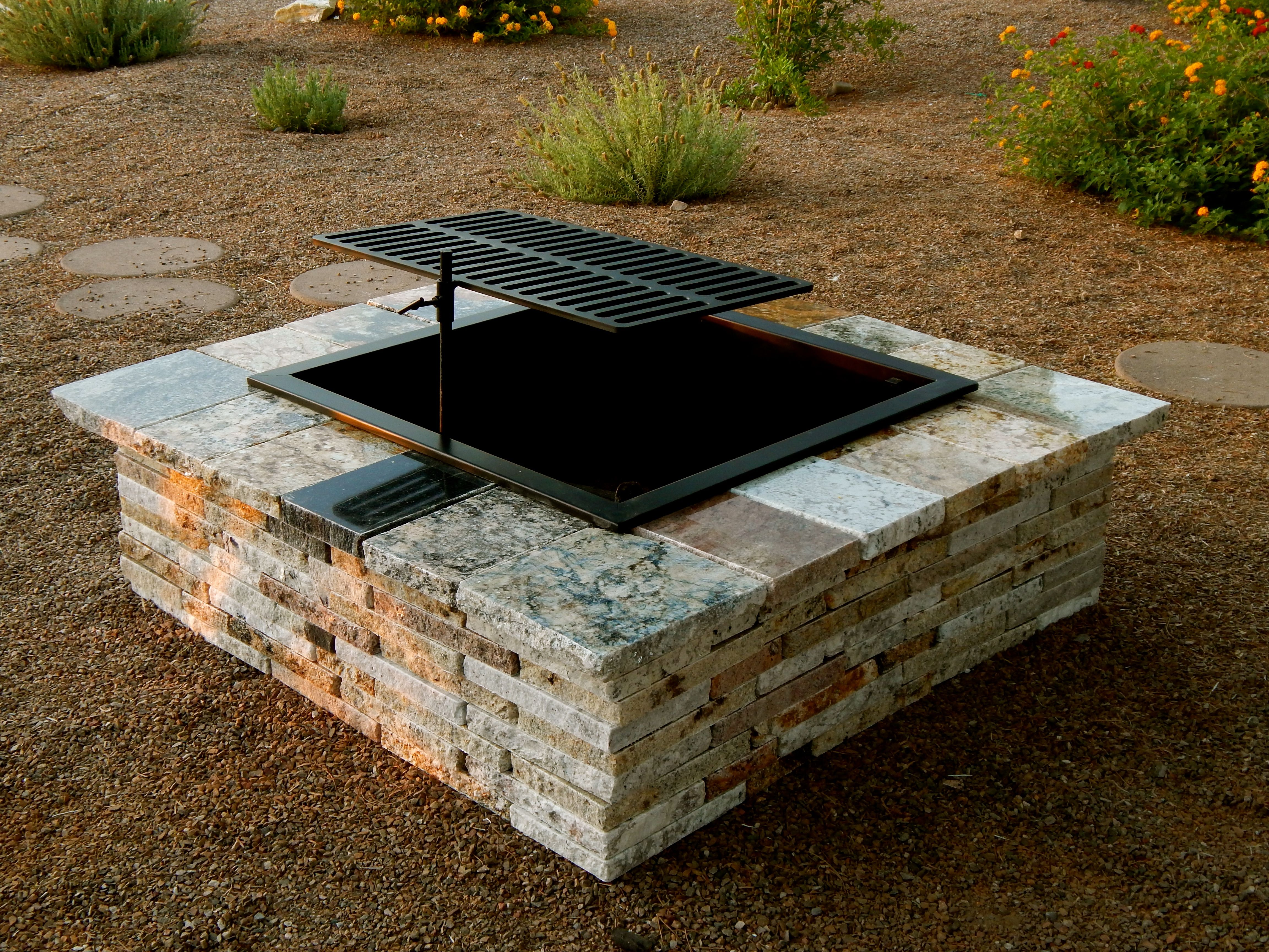 the grillin pit turns your outdoor living space into an outdoor