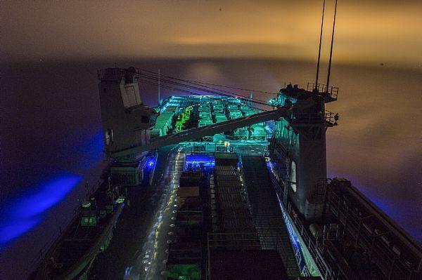 (Dec. 07, 2015) Dock landing ship USS Harpers Ferry (LSD 49) prepares for night time flight operations.