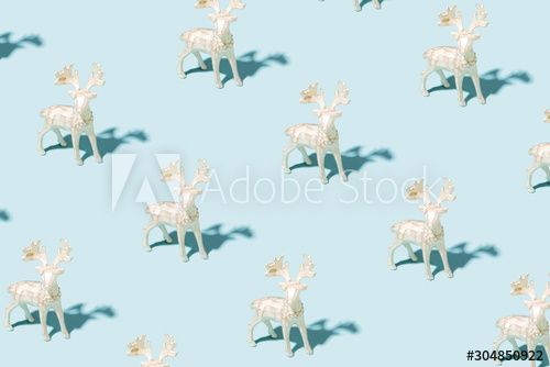 Pattern made of silver reindeer toys on blue background. Christmas and New Year concept. , #Aff, #reindeer, #toys, #Pattern, #silver, #blue #Ad