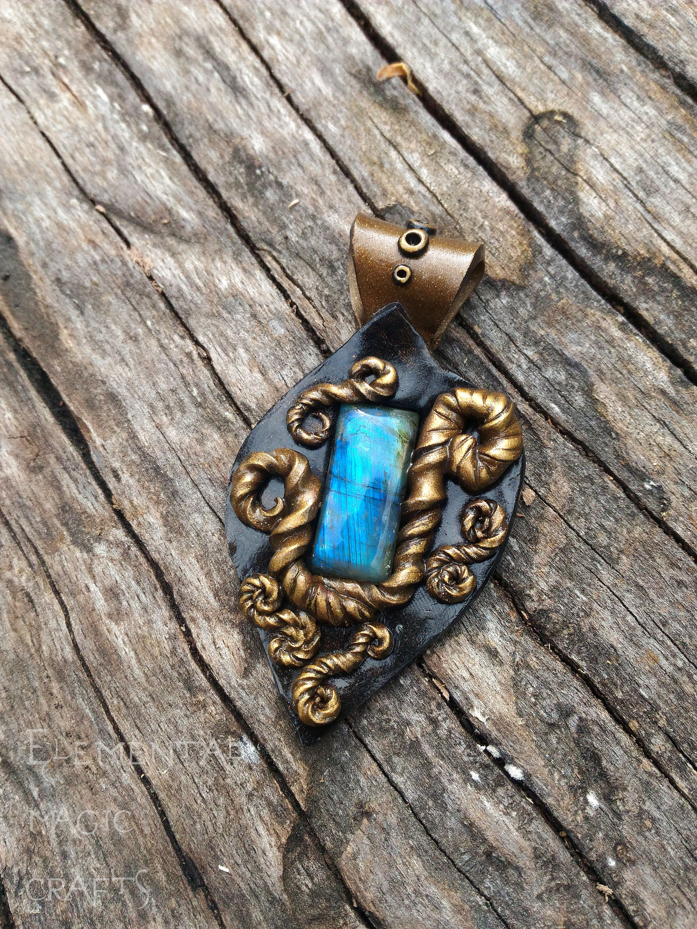 gold or poseidon pendant