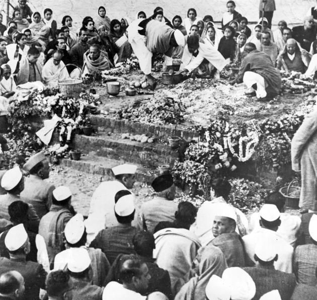 9th February 1948: The ashes of Mahatma Gandhi (Mohandas Karamchand Gandhi, 1869-1948), Indian nationalist leader, are collected at his funeral, held in Delhi and attended by several thousand people