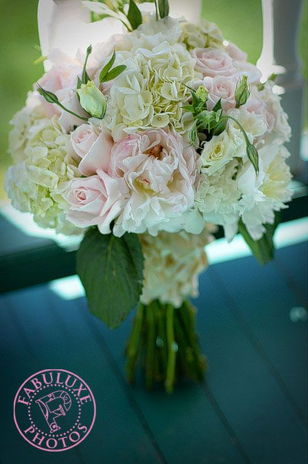 Hand-tied bouquet composed of hydrangea, peonies, roses and ...