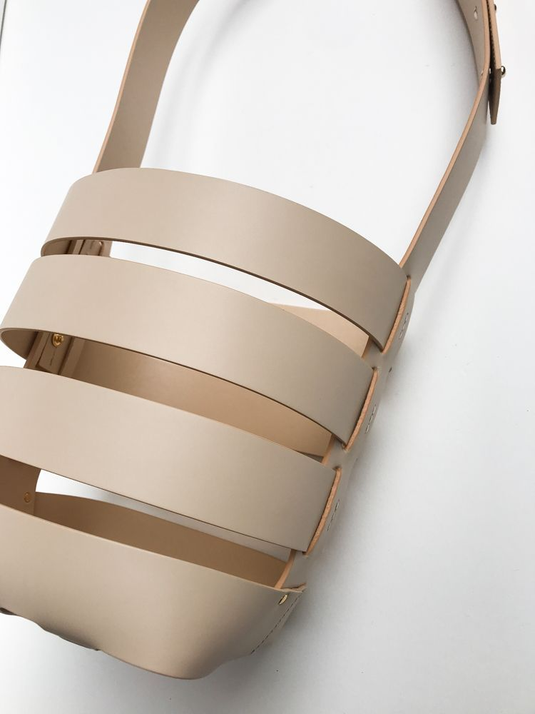 Nude Cage Bucket bag | Paco Rabanne #paco #rabanne #leather #nude #puzzle #cage #element #dreamy #exclusive #oneofakind #statement #bucket #bag #modern #fashion #art #minimalist #easy #to #wear #easytowear #style #love #seau #cuir #pacorabanne #cutout #leather