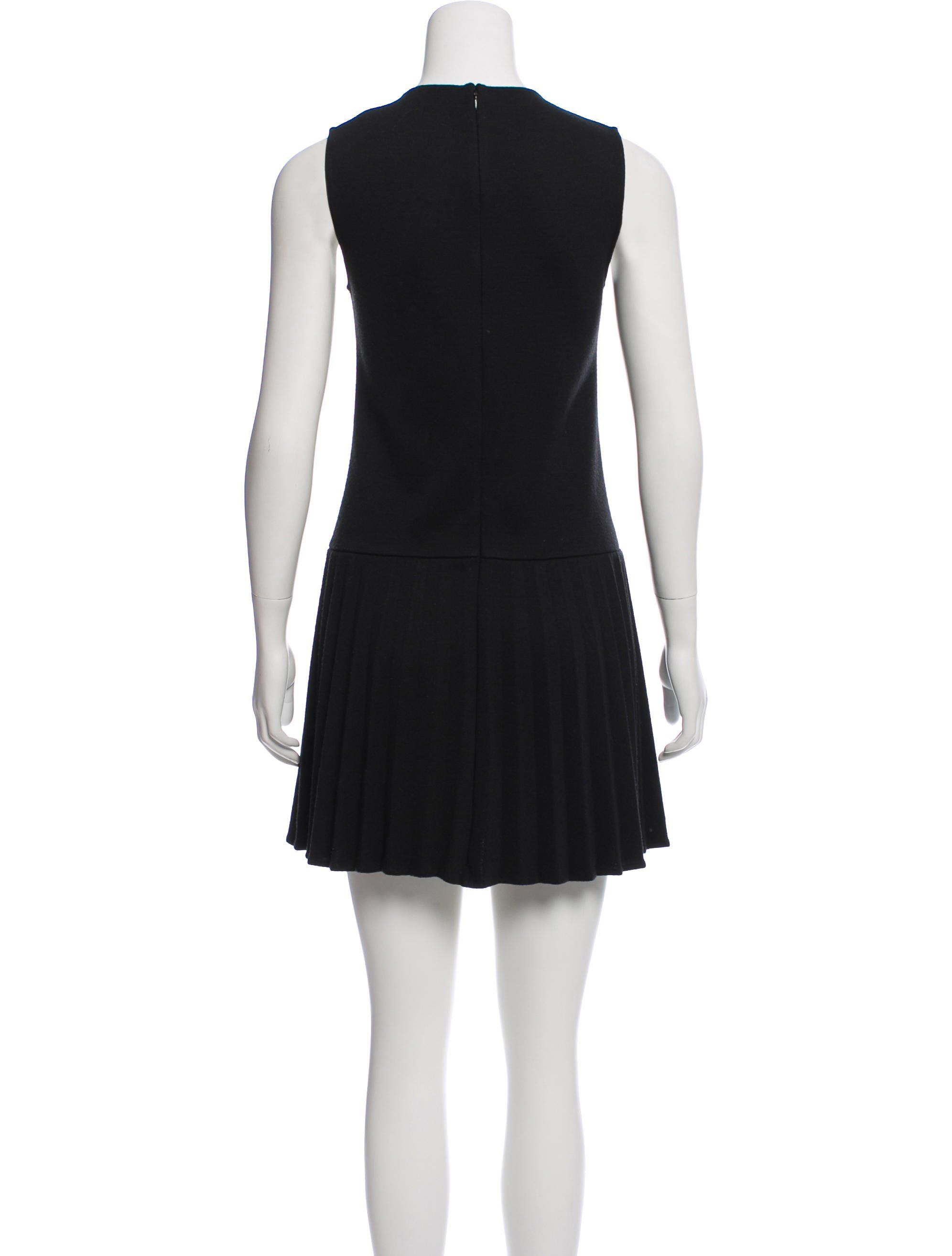 1a7fa2225a990 Black Theory textured sleeveless mini dress featuring pleat detail at skirt  and concealed zip closure at center back.