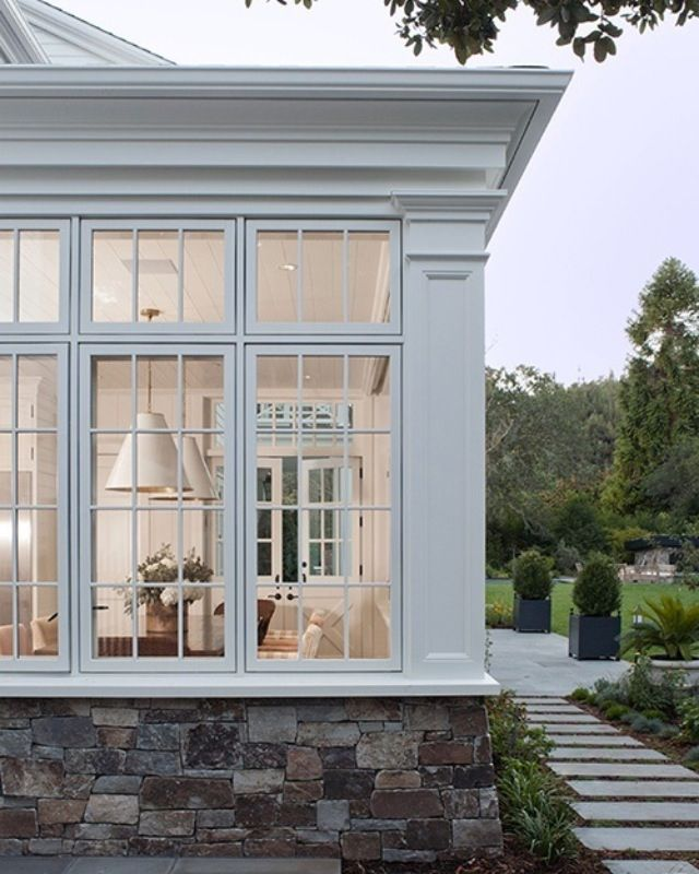 Vertically long windows with exterior trimmings. Might be able to ...
