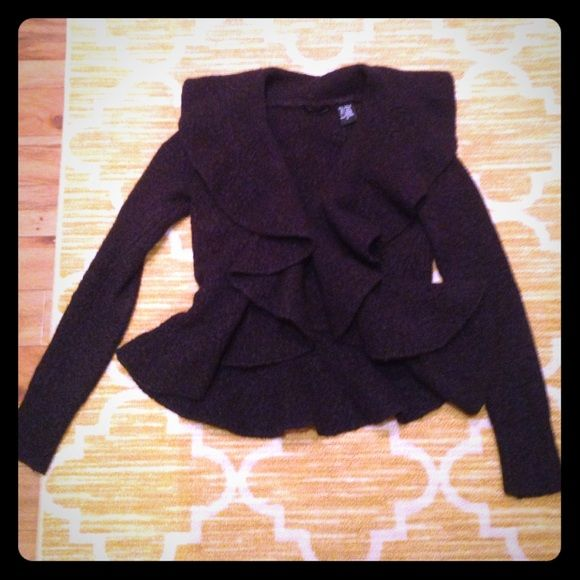 Ruffle front black cardigan w/ style!  Purchased from Victoria Secret online, worn a few times. So feminine and goes great with jeans and/or a pencil skirt. Can be worn casually or formally. Hook closure in front. Offers accepted.  Moda International Sweaters Cardigans