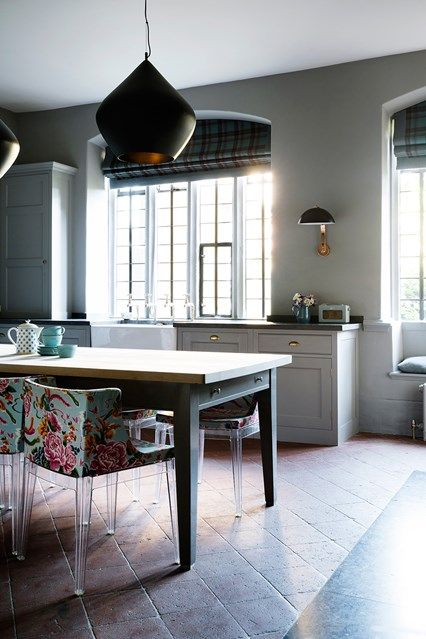 Modern Country House Kitchen with floral pattern chairs in Kitchen Design Ideas on HOUSE. Stone tile flooring and hints of dark duck egg blue in this kitchen at a Somerset country house.