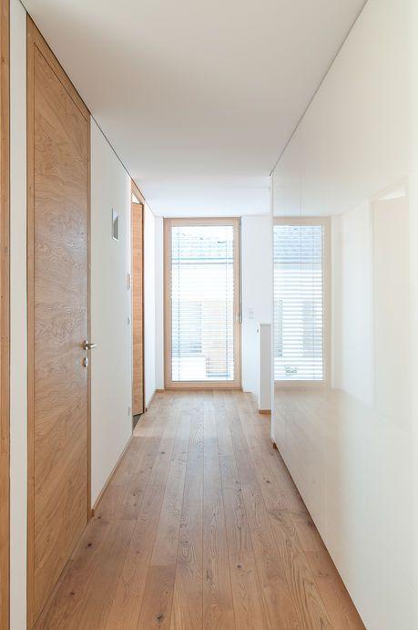 Einfamilienhaus# Götzis# moderner Holzbau# Lehmputz# Holzfassade# moderne Architektur# Design haus# luxsushaus mit pool #eingangsbereichhausinnen