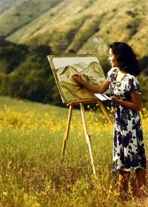 Elizabeth Taylor painting on a hill, June 1947