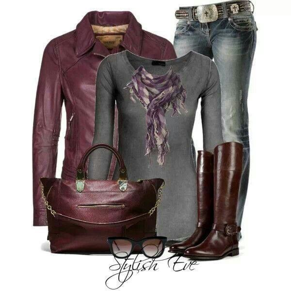 "Gray long sleeve shirt and maroon leather jacket with jeans and brown ""riding"" boots."