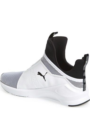 Free shipping and returns on PUMA 'Fierce Core' High Top Sneaker (Women) at Nordstrom.com. In collaboration with Rihanna's Fenty label, PUMA takes street style to the extreme with an architectural shoe that's a high-fashion spin on the classic training sneaker. Bold feminine touches, such as an exaggerated heel and extra-high tongue, update the slip-on silhouette, while a breathable mesh construction and a rubber sole with pivot points at the heel and toe enhance the performance-minded…