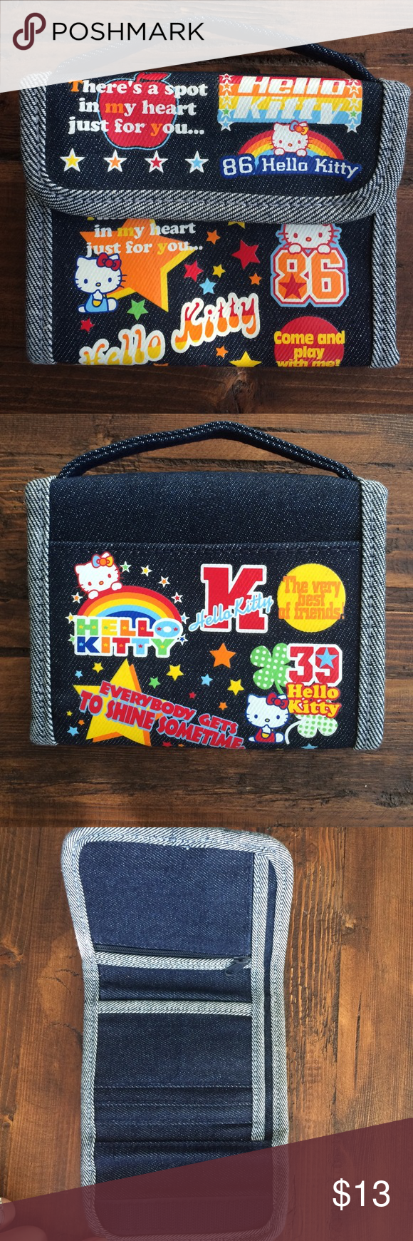 "Hello Kitty Denim Wallet 💗Super cute denim HK wallet. Velcro closure -inside zipped change slot. Room for credit cards/ID 💳 and 💵. Has a handle so it can be carried as a mini purse. Collected - never used!  Dimensions : 5""H(w/handle) 5""L - 10.75""L when open. Sanrio Bags Wallets"