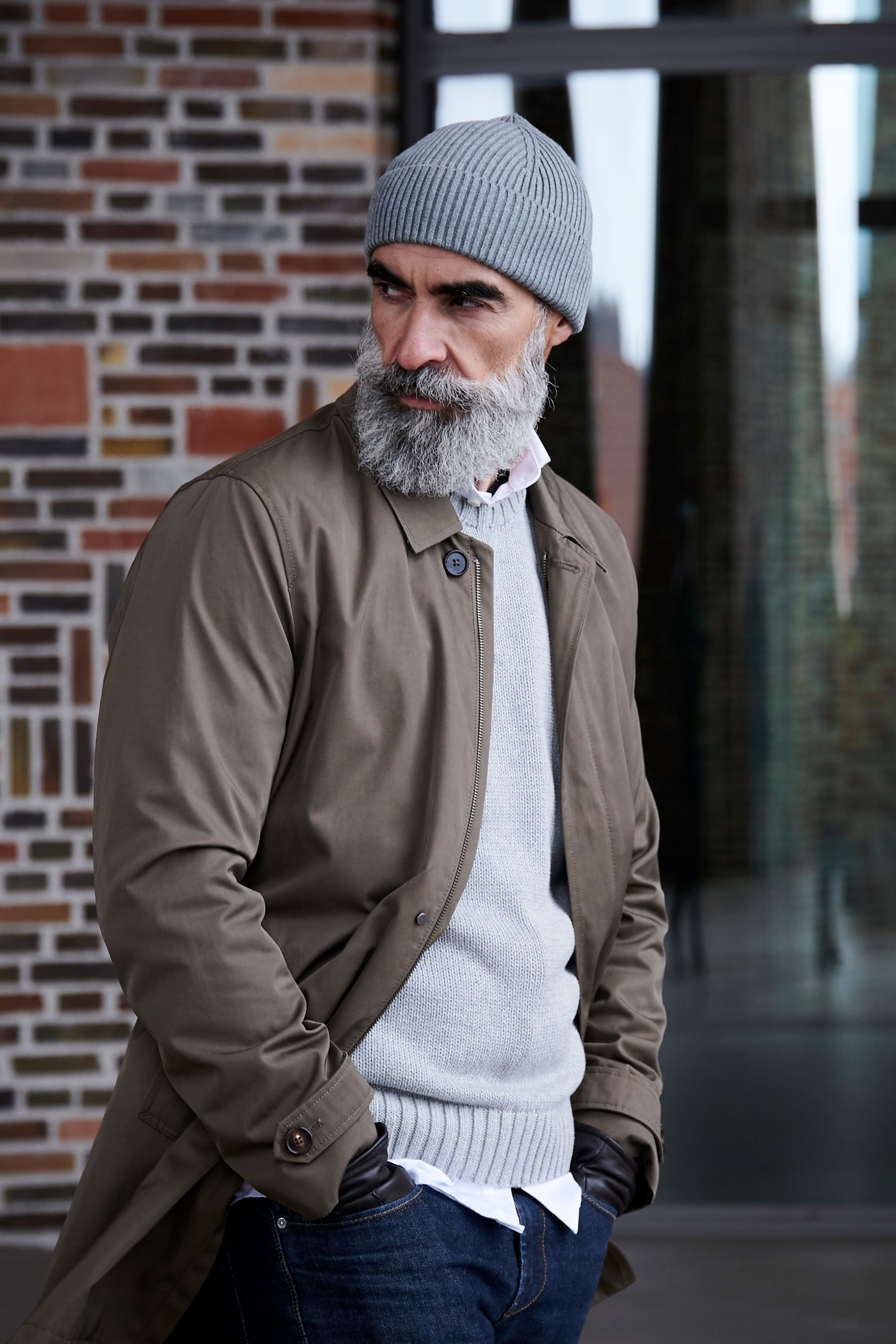 This grey, short beanie sits on your head without