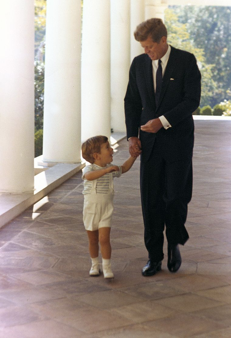 President Kennedy and his son, John F. Kennedy Jr., October 10, 1963. White House, West Wing Colonnade. Photograph by Cecil Stoughton, White House, in the John F. Kennedy Presidential Library and Museum, Boston.