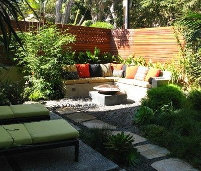 Concrete Corner Wall Seating With Colorful Cushions And Bamboo