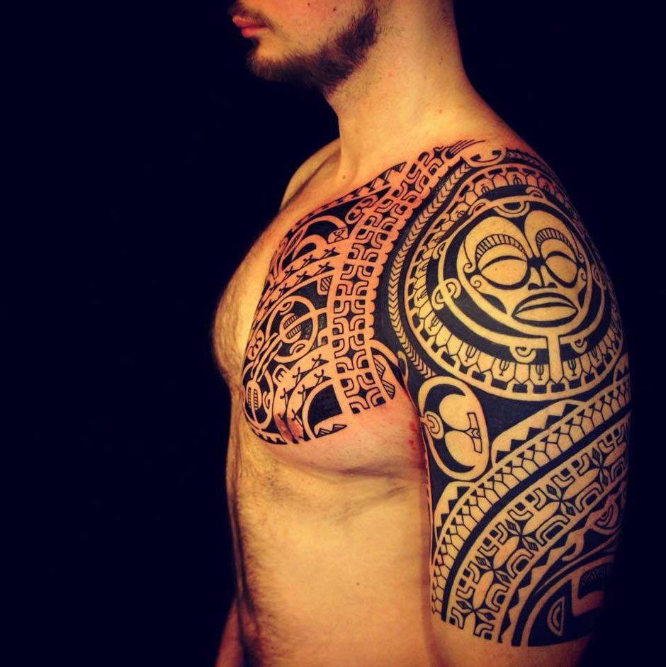 Polynesian tattoo on arm and chest - Polynesian Tribal Chest And Sleeve Tattoo