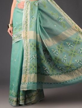 Cyan Chanderi Tissue Chikankari Saree - This  saree is adorned with intricate Chikankari embroidery carried out by women in Lucknow under the organization Kraftistan run by designer Mita Dass. The organisation has been involved in providing a means of livelihood and economic freedom to the women, alongside celebrating the craft that has survived since the Mughal era.