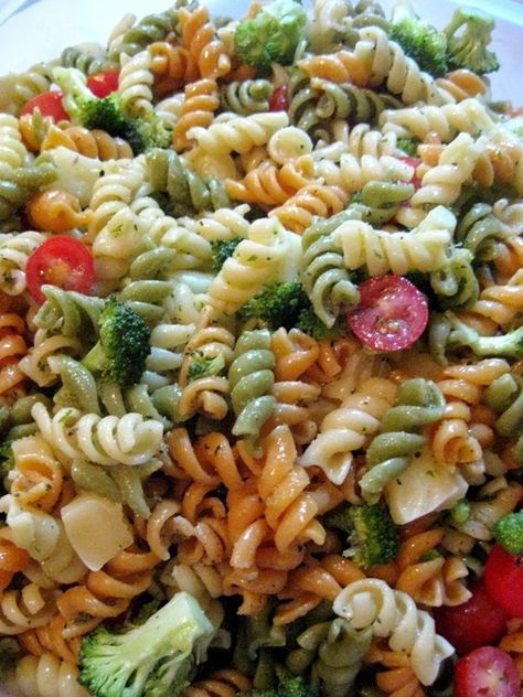 Pasta Salad with Homemade Italian Dressing   Karla M Curry1 box tri-color rotini (or any pasta you prefer) 1 big bunch of broccoli, cut into small pieces 1/2 container grape tomatoes, halved or quartered 1/2 block montery jack cheese, cubed 1 recipe Homemade Italian Dressing (recipe follows)
