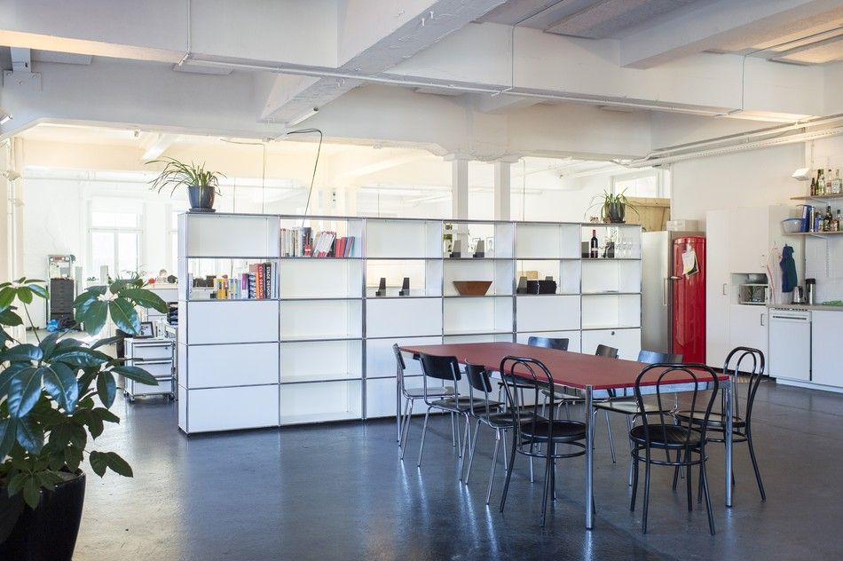 """Bands like The Prodigy and The Roots used to perform here – the Werkspace was a club for twenty years. """"Anyone who didn't party here before would never guess that this place was once a club,"""" says Christoph Haller, Werkspace's co-founder. His desk now sits where the stage once stood.Five companies..."""