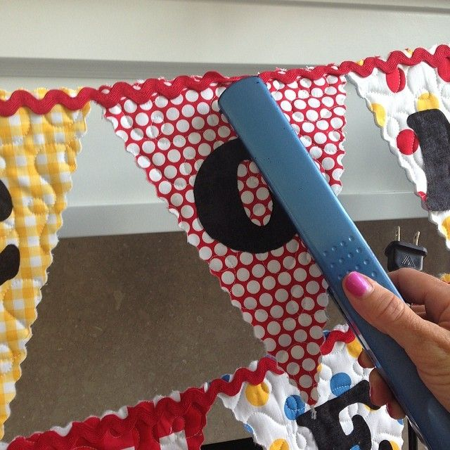 Last minute touch ups? Use a flat iron to iron letters onto your holiday banner!