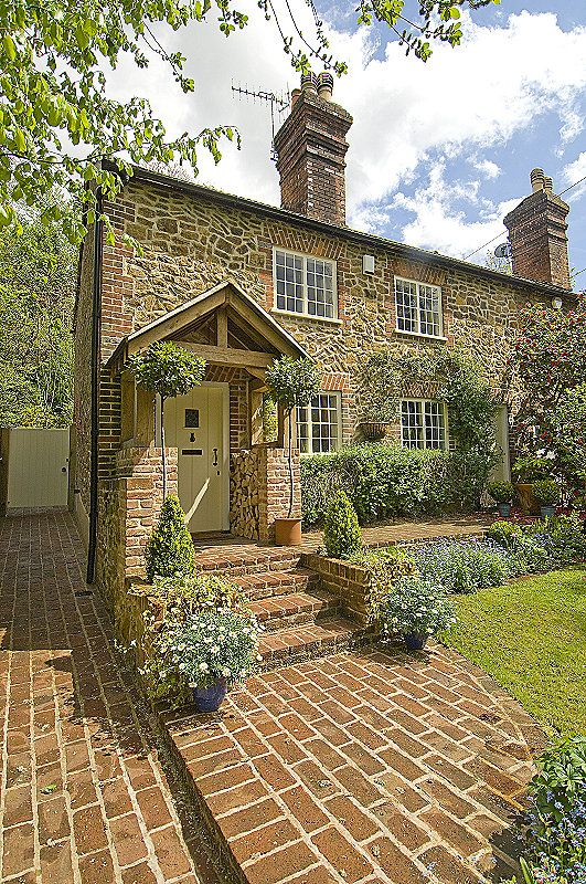 Front Elevation: We added an oak porch, new steps and paved areas at the front. All stone work was repointed in lime mortar, the windows are original to the house 1856.