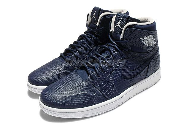 online store 2dcab 32db3 The Air Jordan 1 High Nouveau returns in an all-snakeskin upper featuring a  simple Midnight Navy Pure Platinum combination. Style Code  819176-407