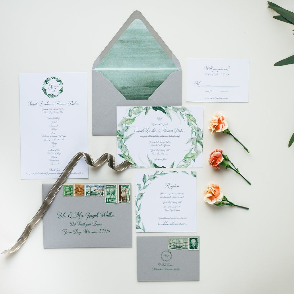 Rich foliage invitation with muted greys and an organic feel of greenery. A simple watercolor envelope liner and grey envelope is the perfect backdrop for a classic font.