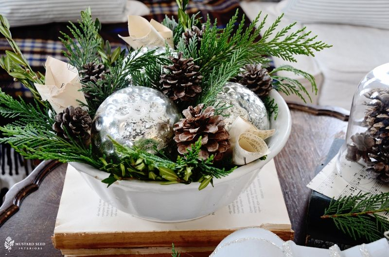 Natural rustic bowl of greenery, mercury glass, pine cones for Christmas