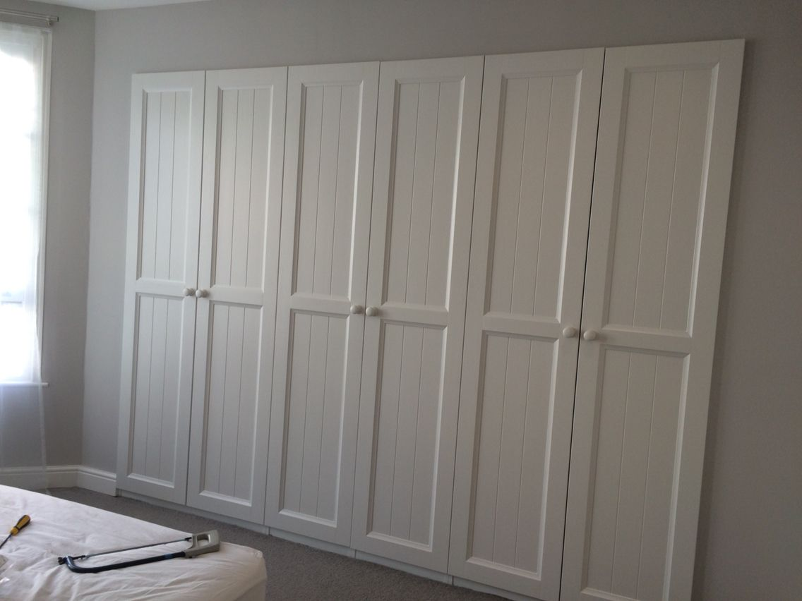 ikea pax wardrobes built into a stud wall hurdal doors painted in farrow and ball strong white. Black Bedroom Furniture Sets. Home Design Ideas