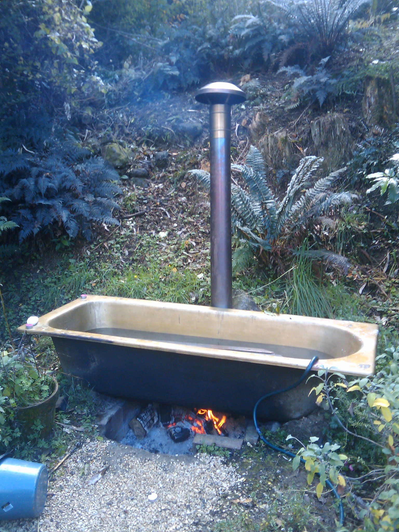 How cool! A fire underneath heats the water in the bath. A wooden ...
