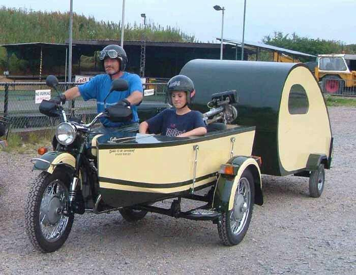 Motorcycle with sidecar and teardrop trailer.   even the boat (with motor) gets to go.