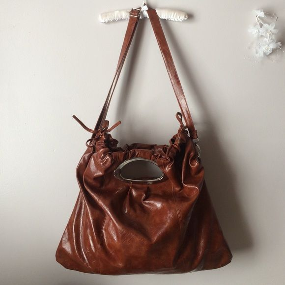 """Huge Brown Bag Brow Faux Leather. All Man Made Material. Silver Hardware. Zip Closure. Draw String Sides Sinch Opening. Interior has 1 Zip Pocket, 2 Slip Pockets. This Bag is Very Large and Spacious. Can be Worn as a Croosbody, Shoulder Bag or Tote. Straps are Removable. Some Wear on the Hardware and a few Light Scuff Marks on the Shell. Measures 18.5H x 20""""L x 11""""D, Drop Length 5""""-19"""" Adustable. @winans79 FINAL PRICE NO TRADES NO PAYPAL Bags Shoulder Bags"""
