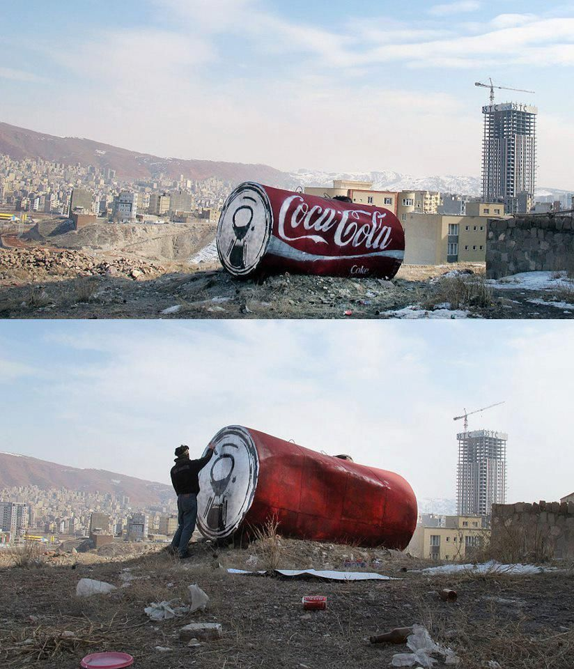 A rusted tank becomes a giant coca cola can by iranian street art duo icy and sot